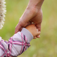 child holding hands
