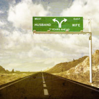 Divorce Ahead Road Sign, husband west pointing right, wife east pointing left