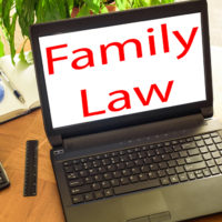 lap-top-reads-family-law