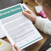 Wife holding divroce decree form