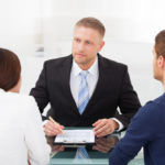 A divorce lawyer speaking with a couple