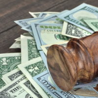 Judge's gavel on top of pile of cash