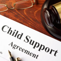 Child support agreement document next to gavel