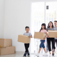 Kids moving out of their current home with boxes