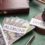 money with alimony caption and gavel with divorce caption