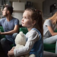 Upset, frustrated little girl tired of parents fight