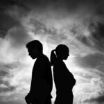 Man woman standing with back facing each other. Argument, and disagreement concept.